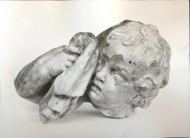 The head of a crying putto