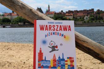 Książka na plaży na tle starego miasta w Warszawie