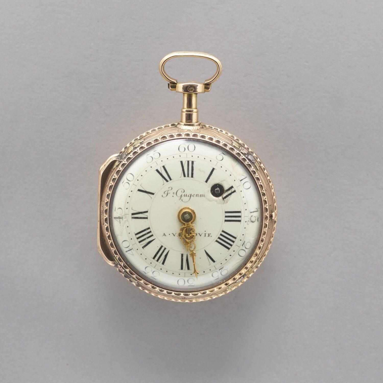 Zdjęcie starego zegarka kieszonkowego wzłotej obudowie.