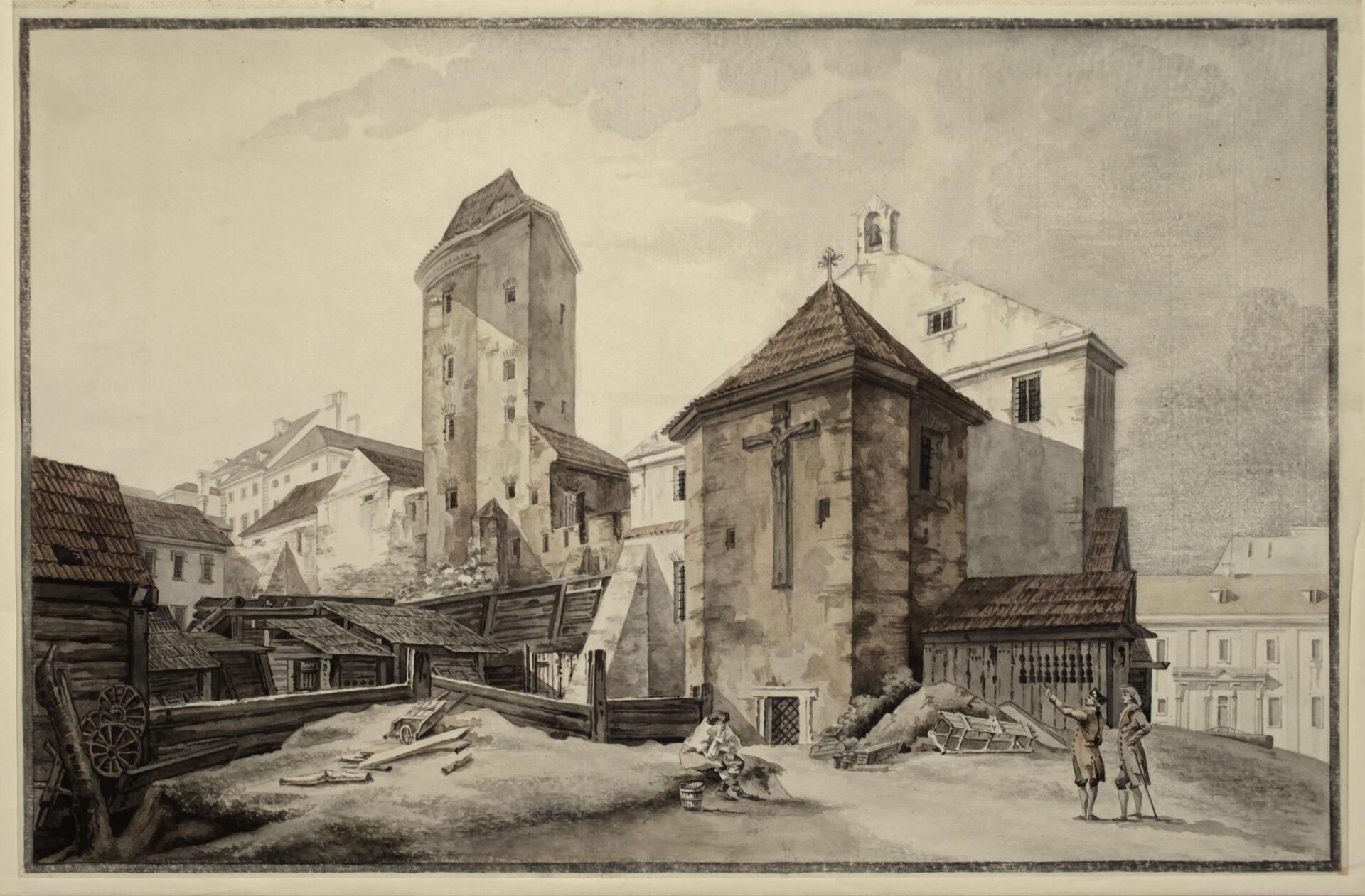 Przy drewnianych zabudowaniach wysoka wieża onieregularnym kształcie. Obok murowany piętrowy budynek, doktóregoprzylega kaplica. Najej zewnętrznej ścianie wisi duży krzyż.