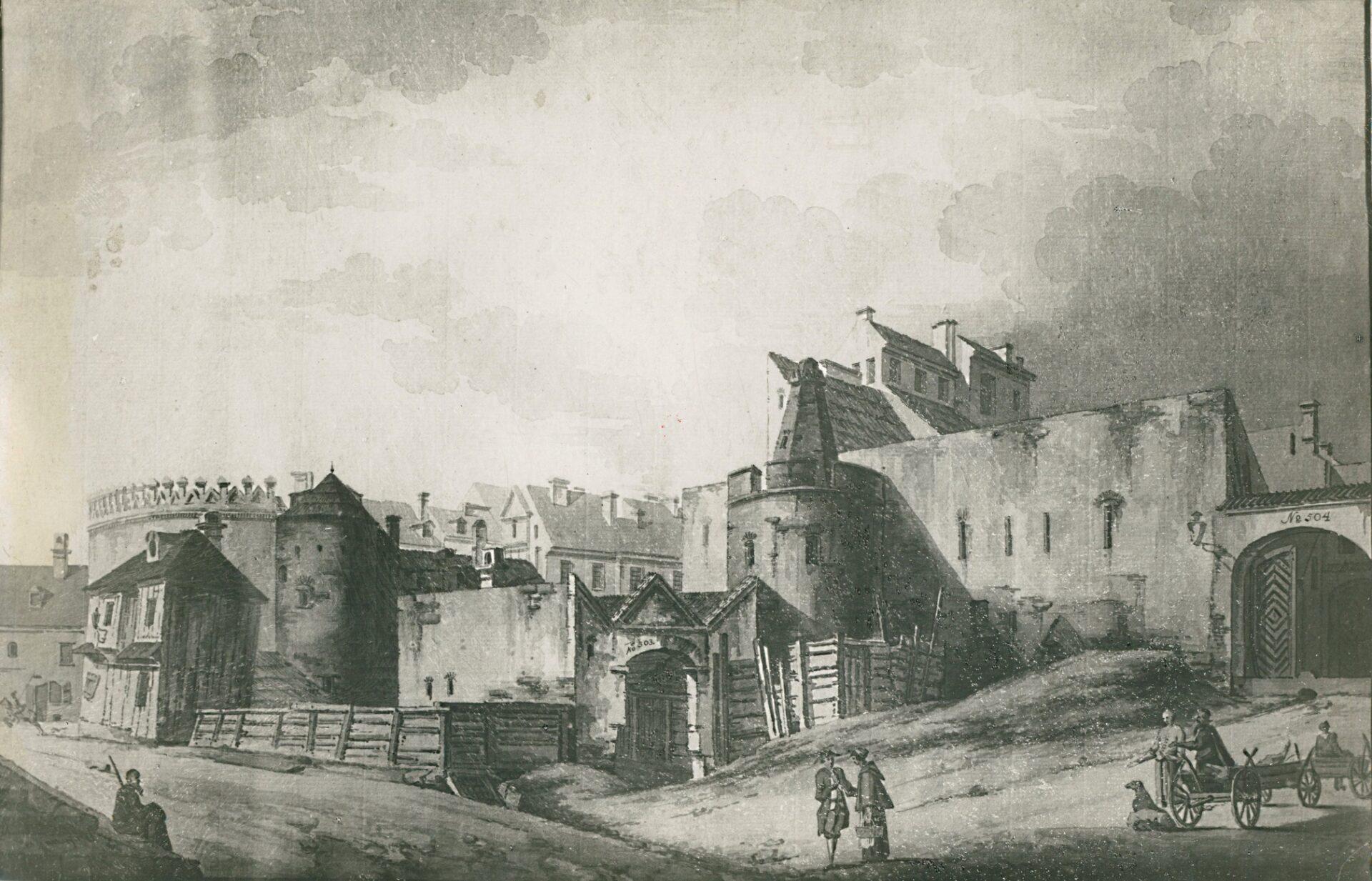 Fragment muru obronnego zpółokrągłą basztą zotworami strzelniczymi. Kończy ją przerywany mur iostrołukowy szczyt. Wtle kamienice Starego Miasta.